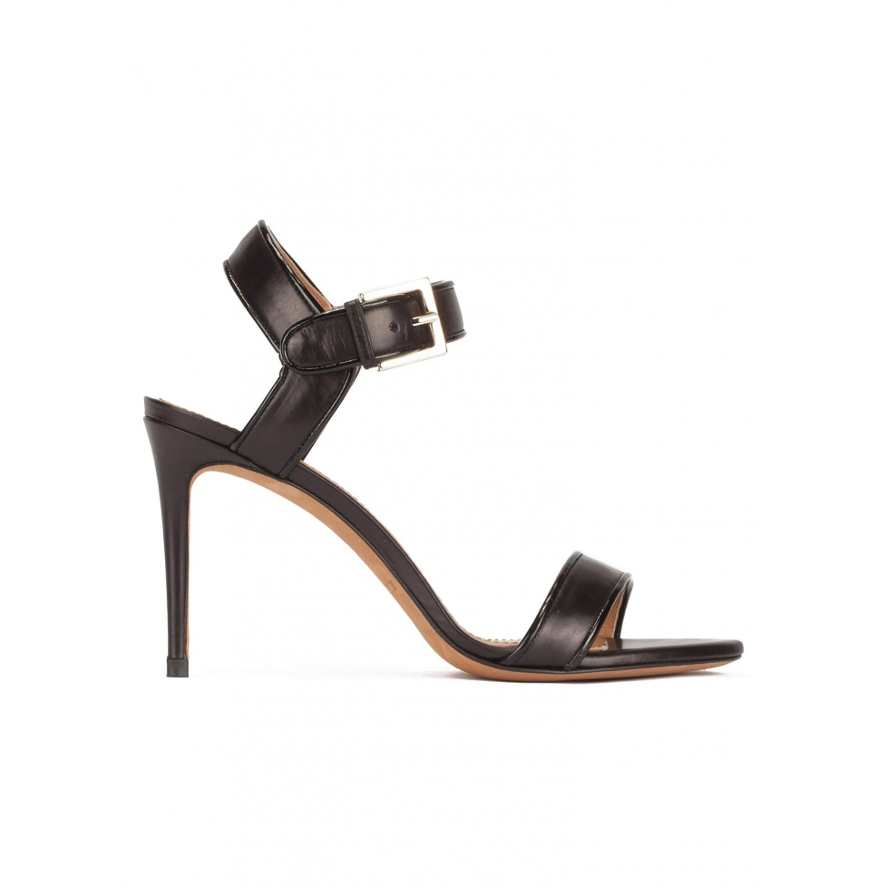 High stiletto heel sandals in black leather with patent piping