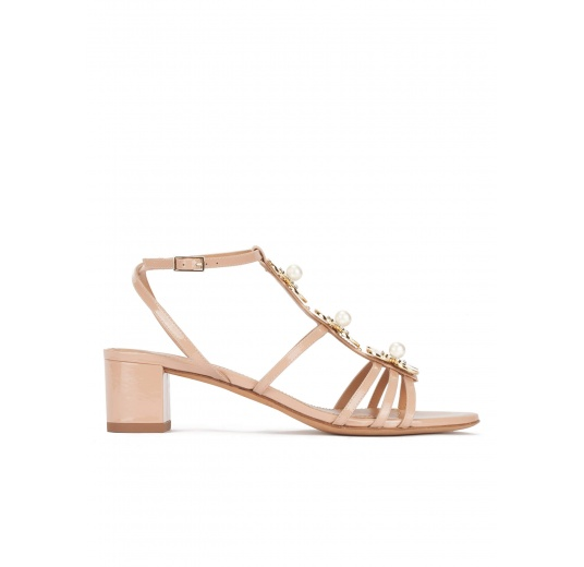 Mid block heel sandal in nude patent with floral trims Pura L�pez