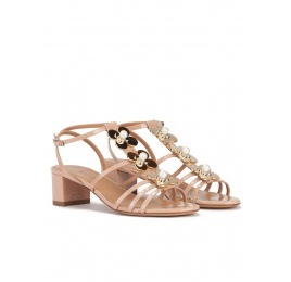 Mid block heel sandal in nude patent with floral trims Pura López