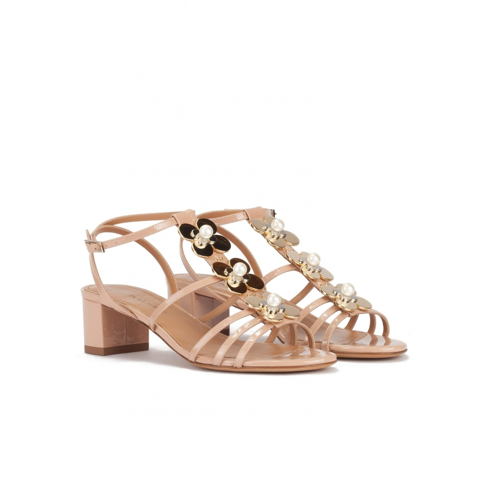 Mid block heel sandal in nude patent with floral trims