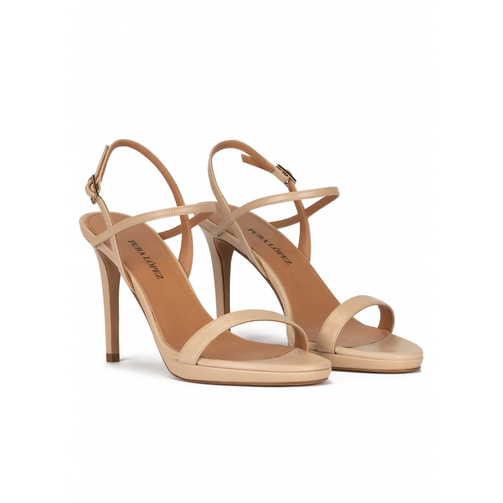 Platform high heel sandals in beige leather