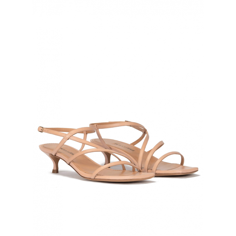 Mid heel sandal in nude leather with strappy design