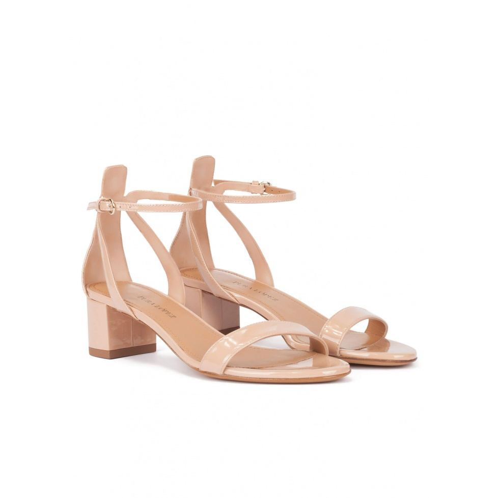 Nude ankle strap mid block heel sandals in patent leather