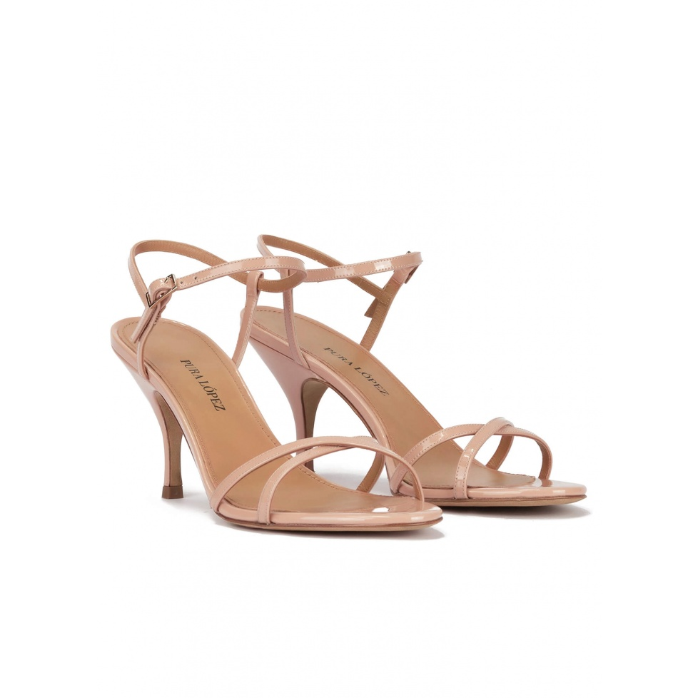 Strappy mid heel sandals in nude patent leather