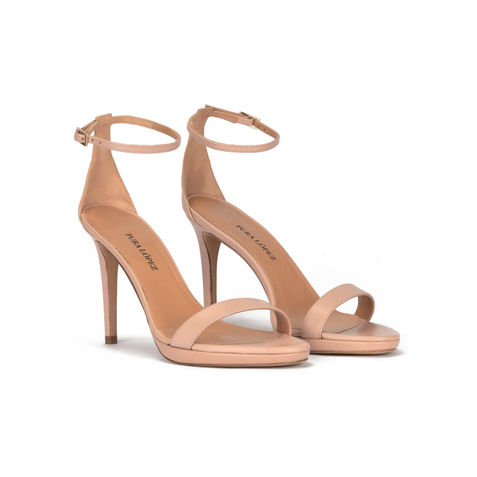 Platform heeled sandals in nude leather