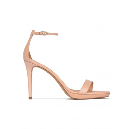 Platform heeled sandals in nude leather Pura López