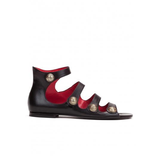 Flat sandals in black leather Pura L�pez