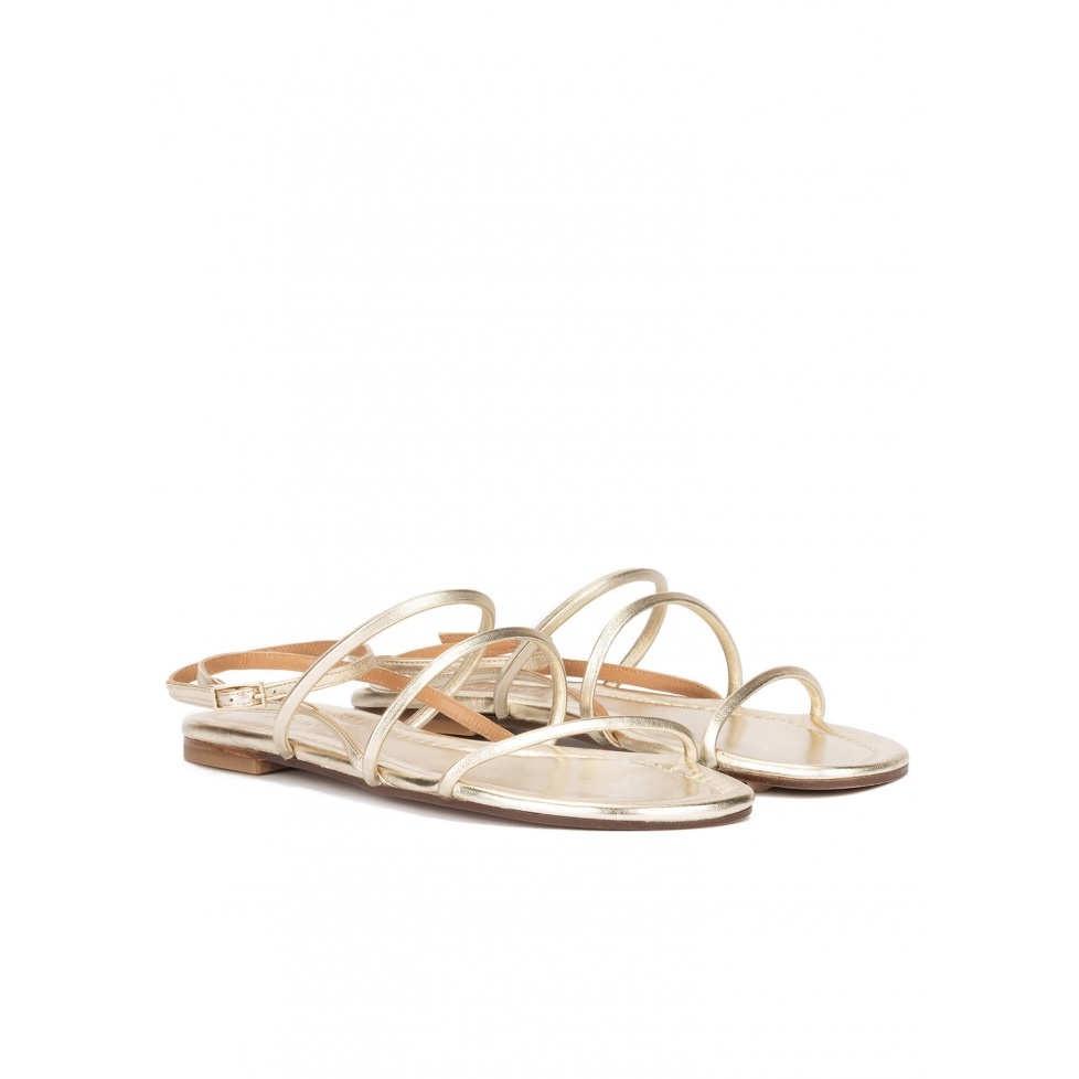 Ankle strap flat sandals in platin metallic leather