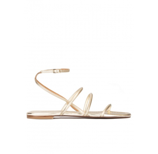 Ankle strap flat sandals in platin metallic leather Pura López