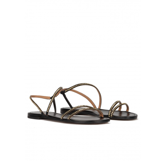 Strappy flat sandals in black leather with golden studs Pura López