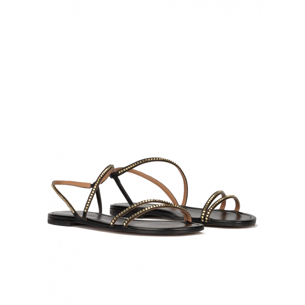 Strappy flat sandals in black leather