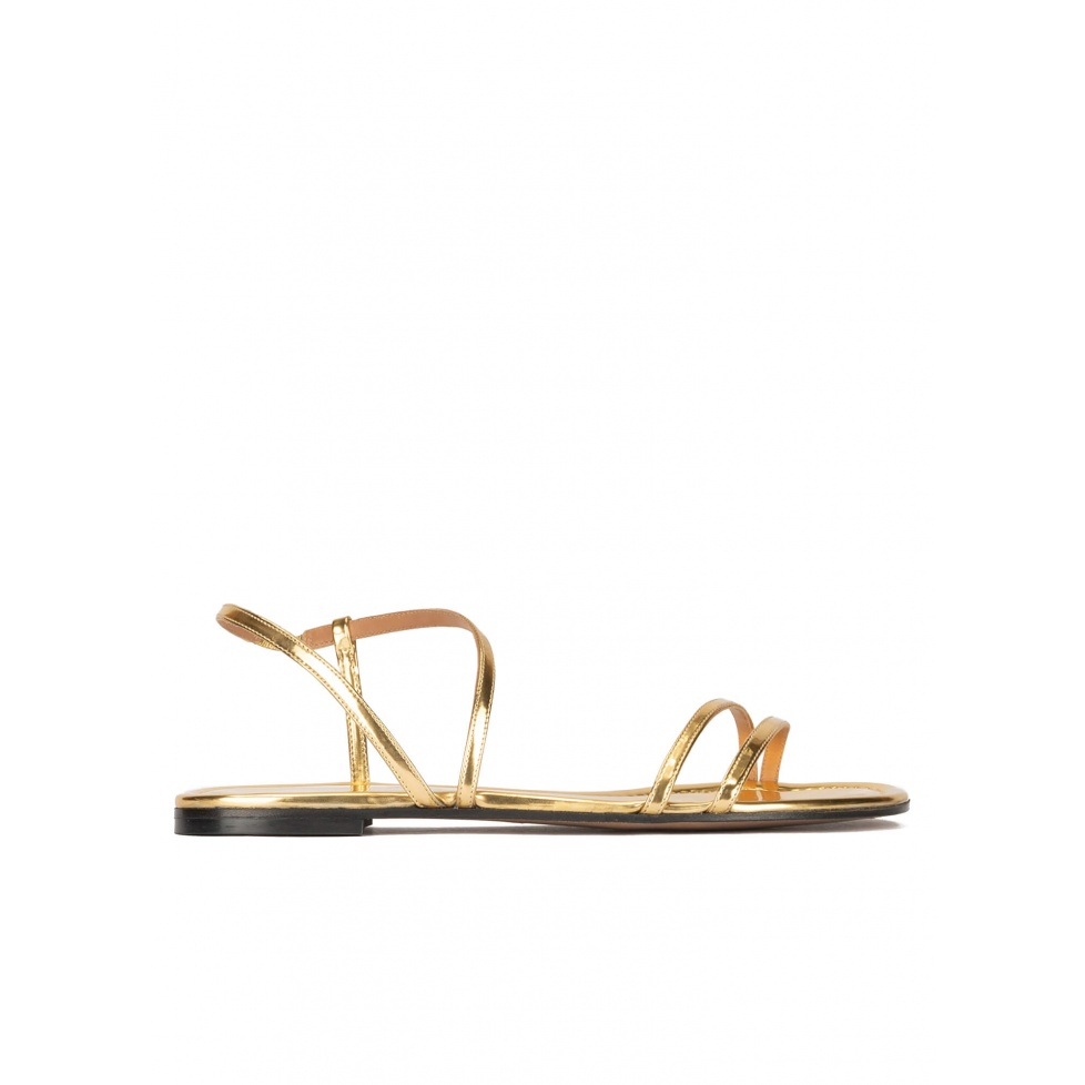 Multi-strap flat sandals in gold mirrored leather