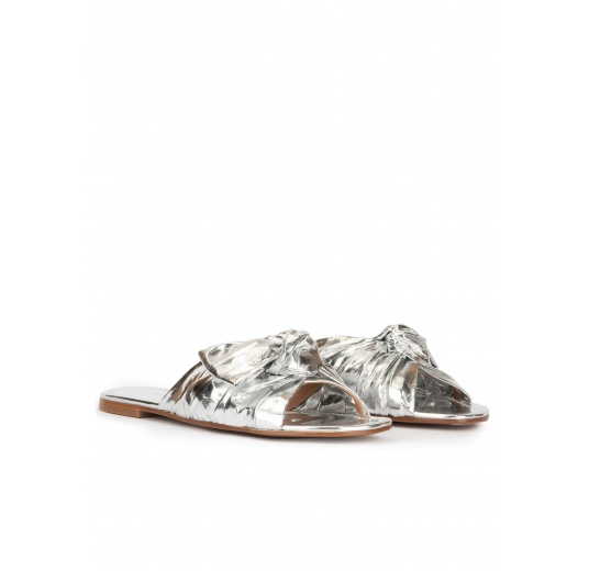 Flat sandals with bow detail made from silver fabric Pura López