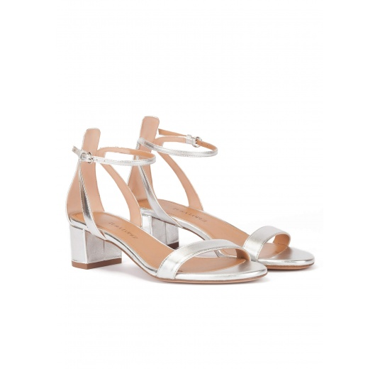 Silver ankle strap mid block heel sandals in metallic leather Pura L�pez
