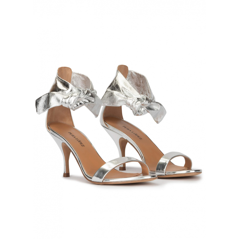 Knotted mid heel sandals in silver leather