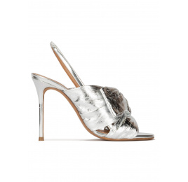 Bow embellished silver high heel sandals in metallic leather Pura López