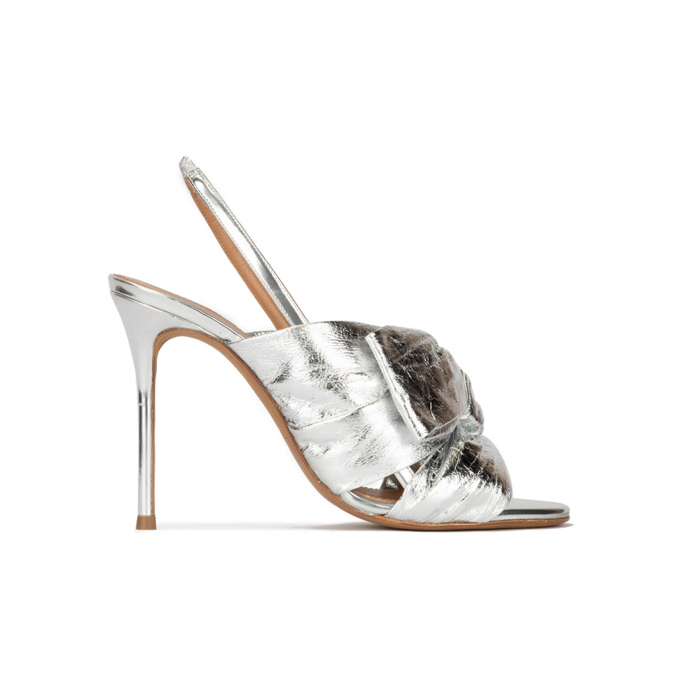 Bow embellished silver high heel sandals in metallic leather