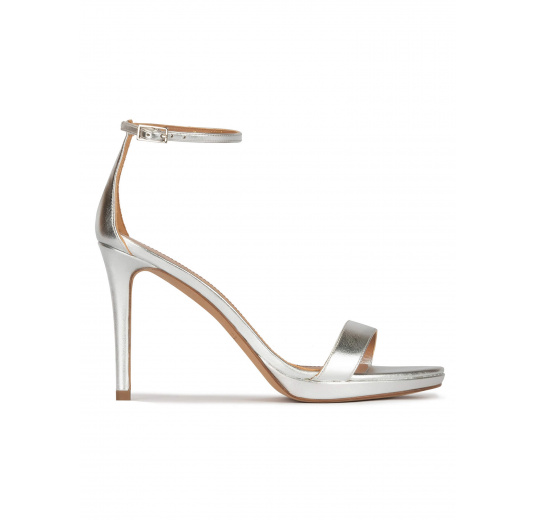 Silver platform heeled sandals in metallic leather Pura López