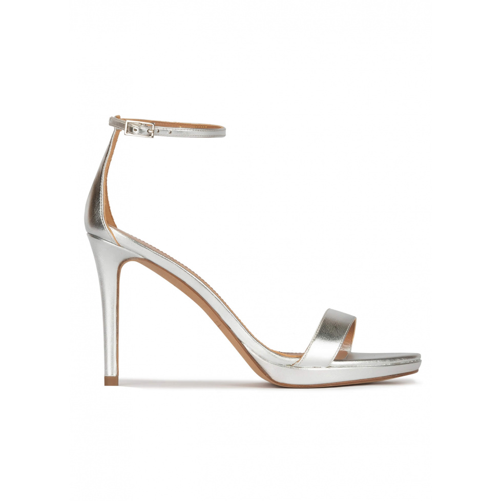 Silver platform heeled sandals in metallic leather