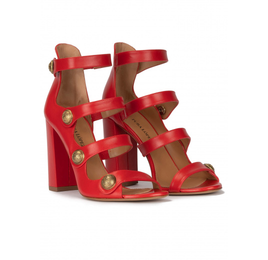 High block heel sandals in red leather with buttons Pura López