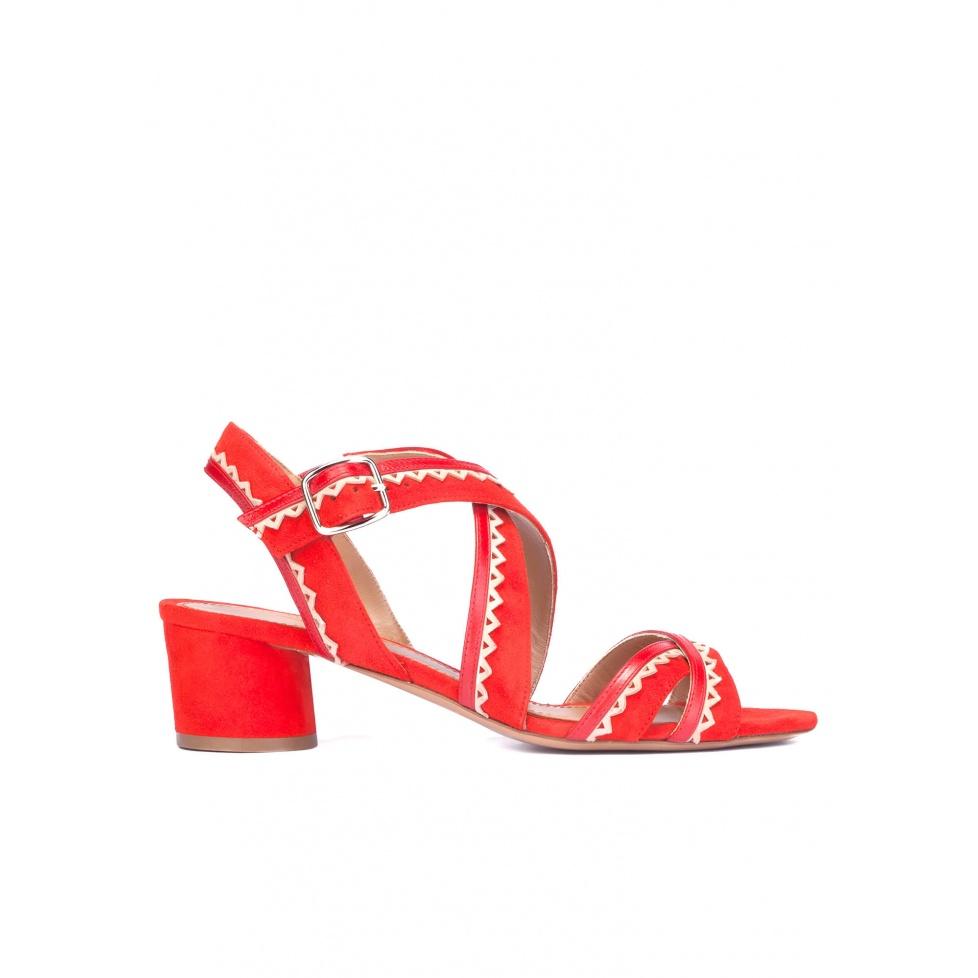 Crossed strap block heel sandals in red suede