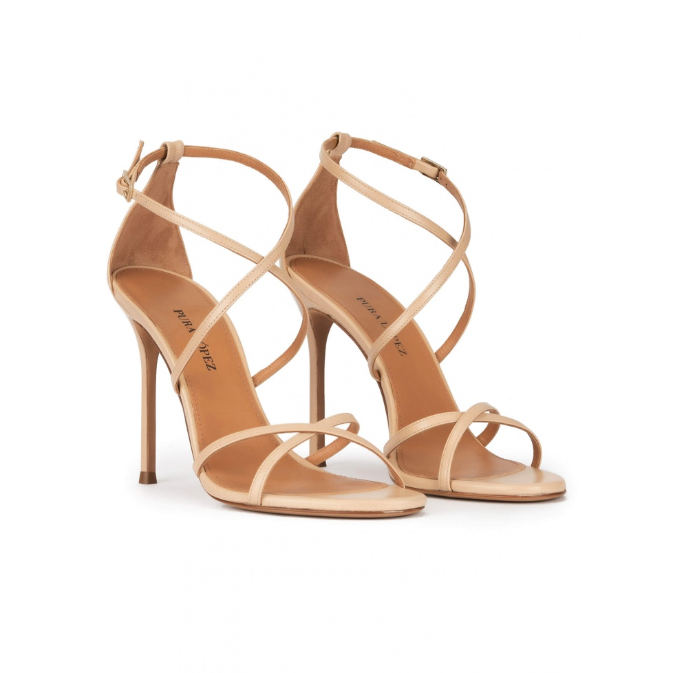 Strappy high heel sandals in beige leather