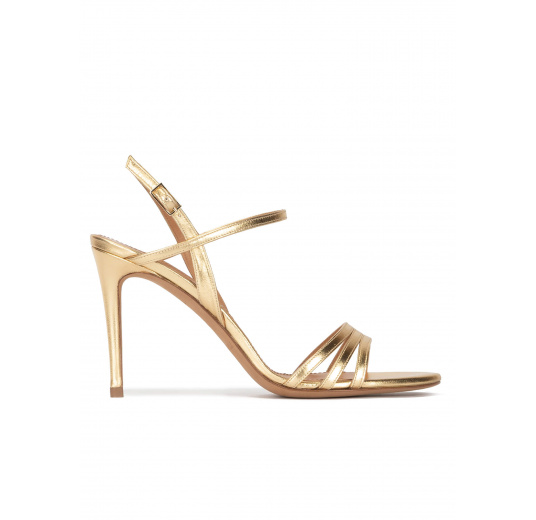 Strappy high-heeled sandals in gold metallic leather Pura López