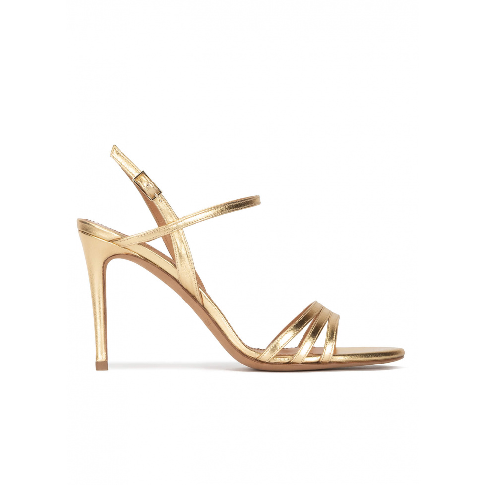 Strappy high-heeled sandals in gold metallic leather