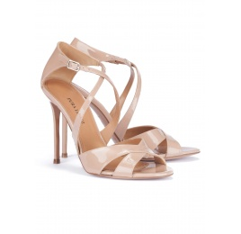Strappy heeled sandals in nude patent leather Pura López