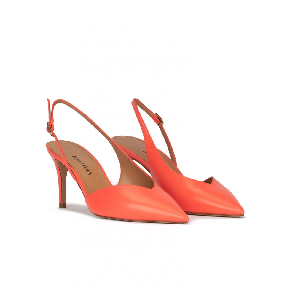 Asymmetric slingback pumps in coral leather