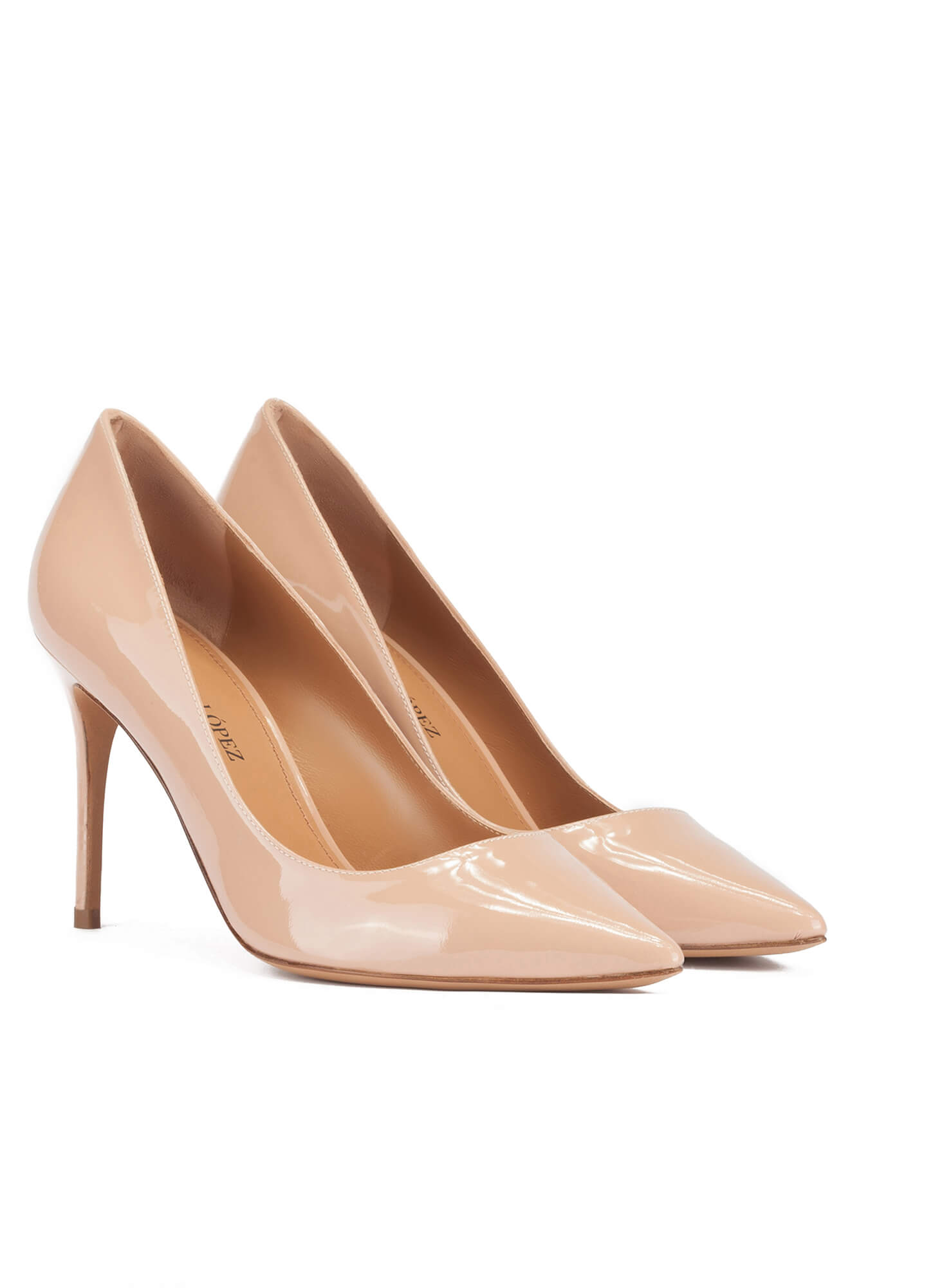 Pointy toe high heel pumps in nude