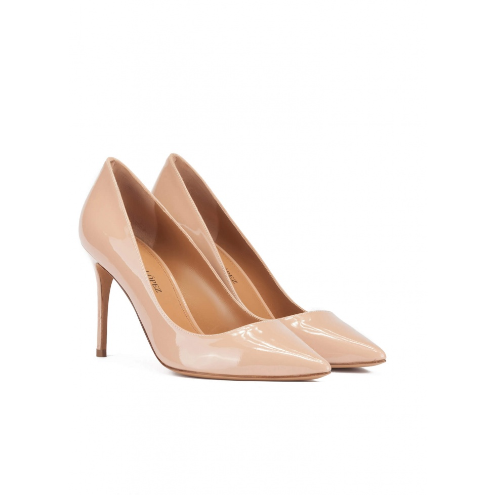 Pointy toe high heel pumps in nude patent leather