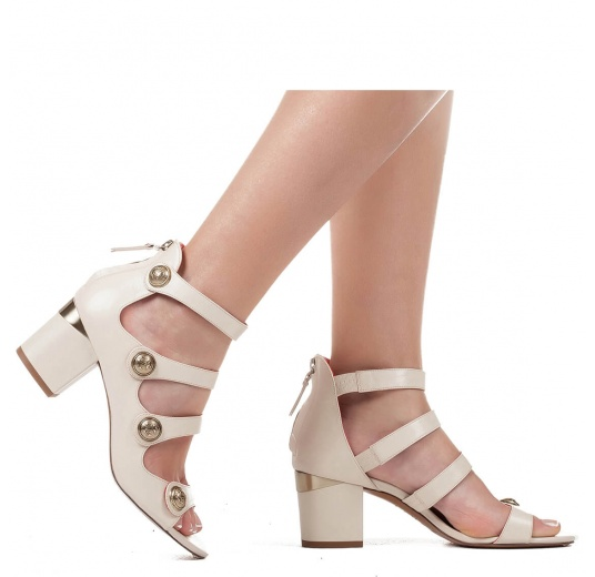 Mid block heel sandals in cream leather with metallic buttons Pura López