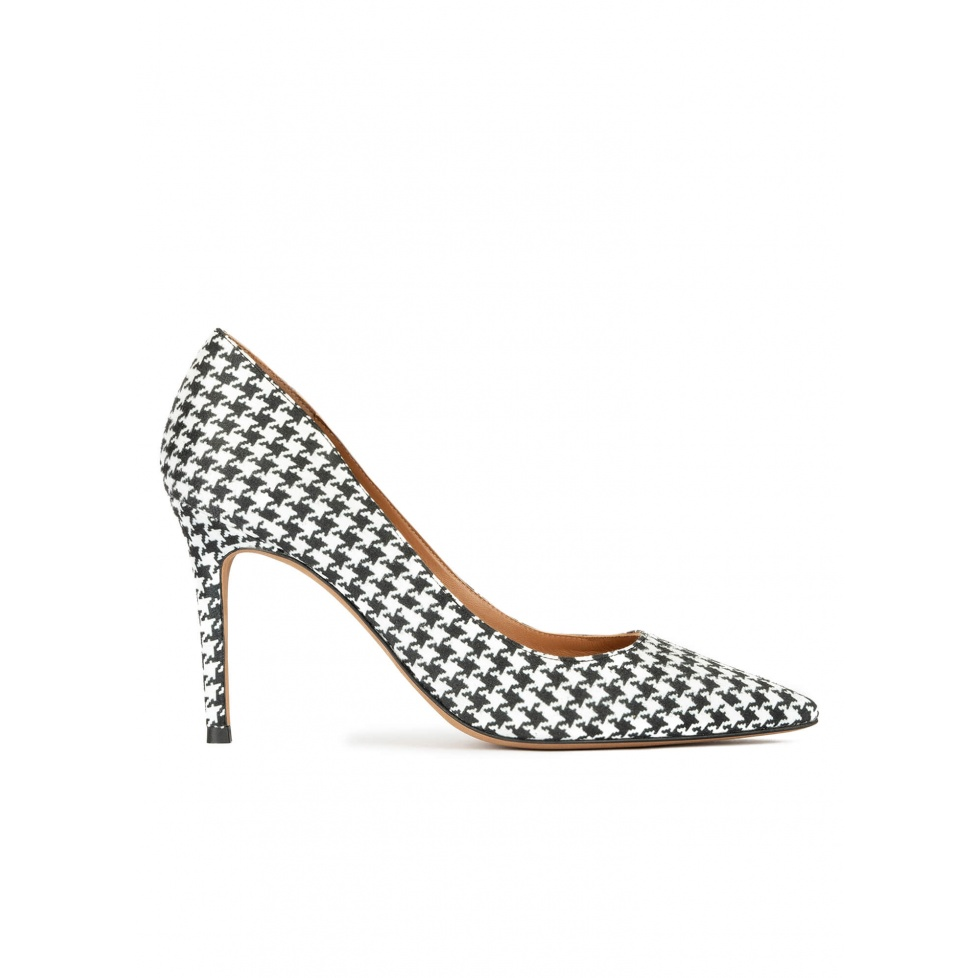 Heeled pointy toe pumps in black and white houndstooth fabric