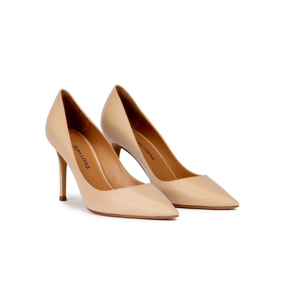 Pointy toe high heel pumps in beige leather