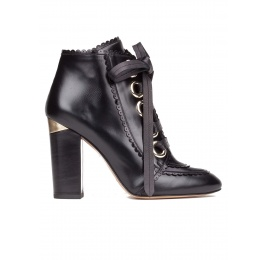 Lace-up high block heel ankle boots in black leather Pura López