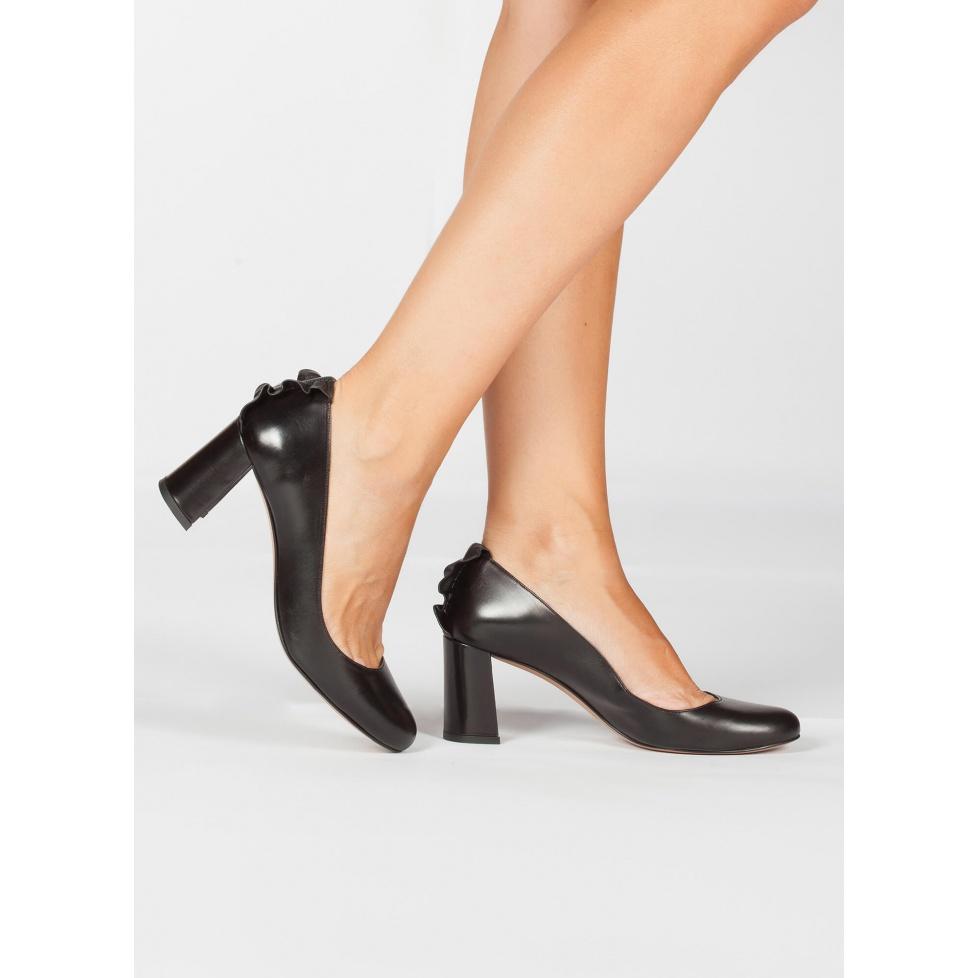 Ruffled black leather mid block heel pumps