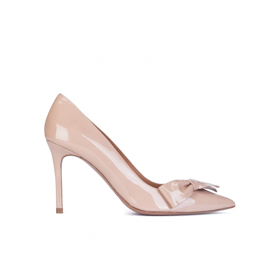 Bow detailed high heel pumps in nude patent leather
