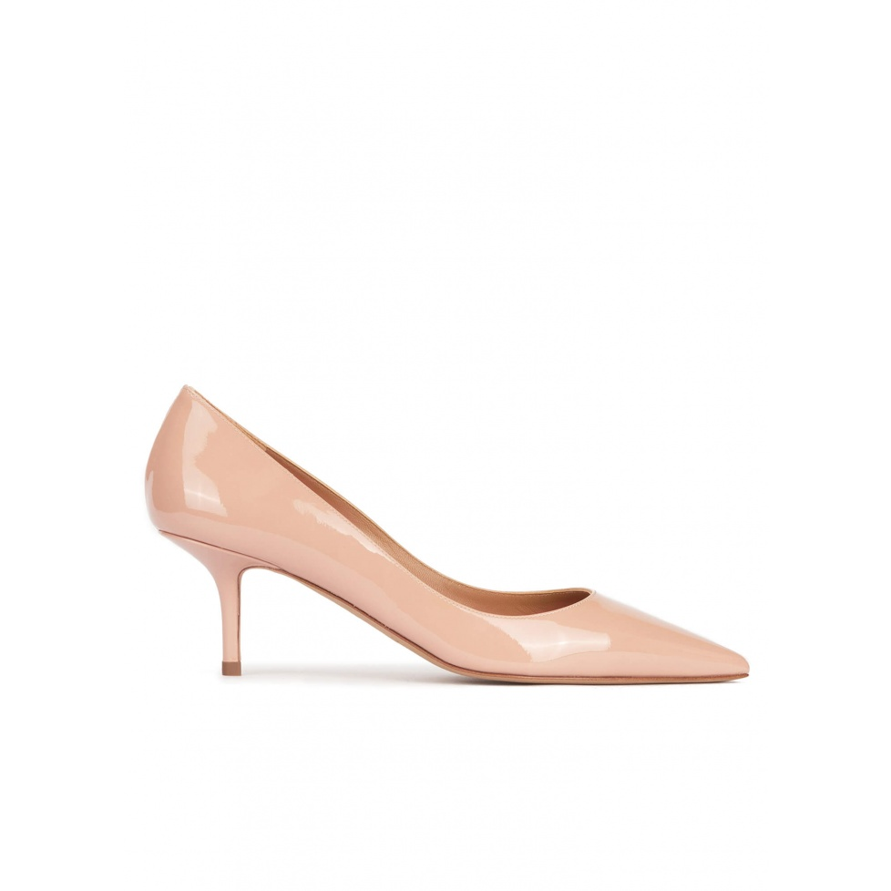 Mid heel pointy toe pumps in nude patent leather
