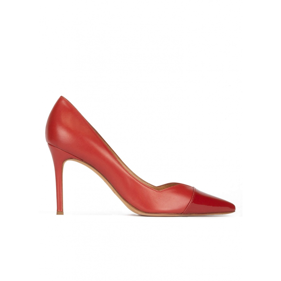 Stiletto heel point-toe pumps in brick-red leather