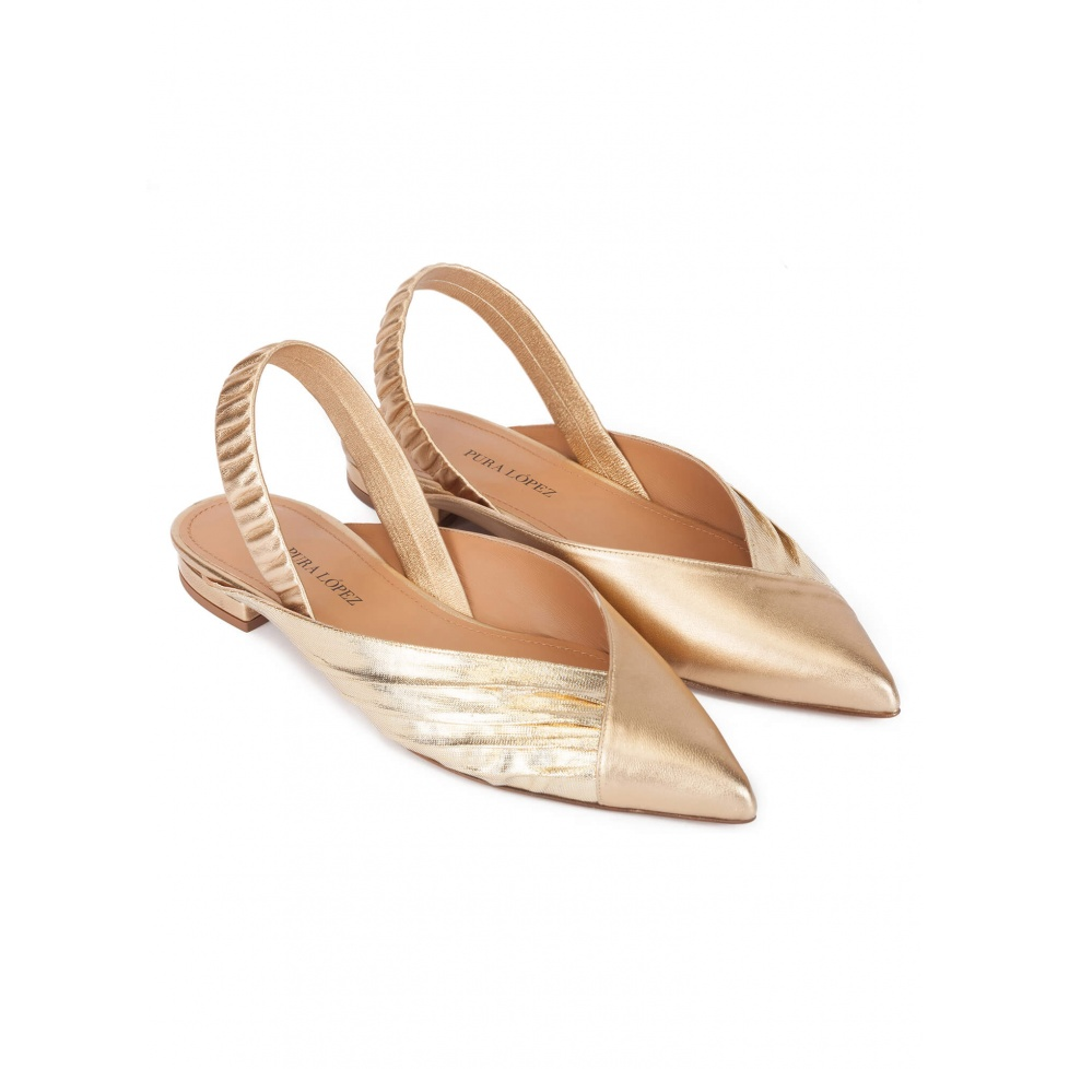 Slingback pointy toe flats in gold leather