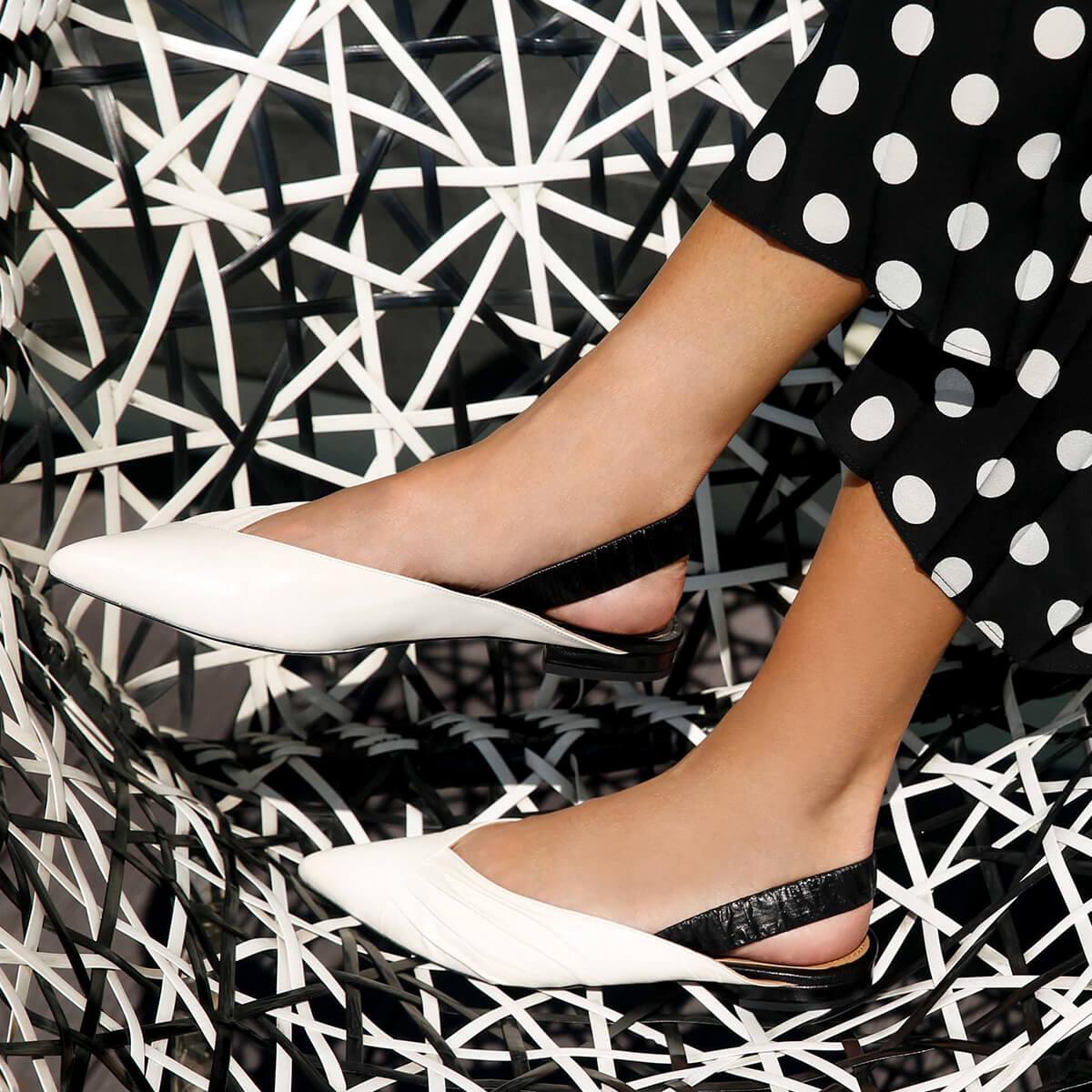 8b842e4d1ac Slingback point-toe flats in white and black leather. Oneka Pura López