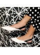 Slingback point-toe flats in white and black leather