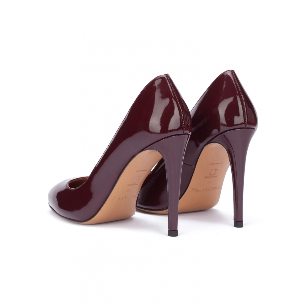 Burgundy patent leather heeled pumps