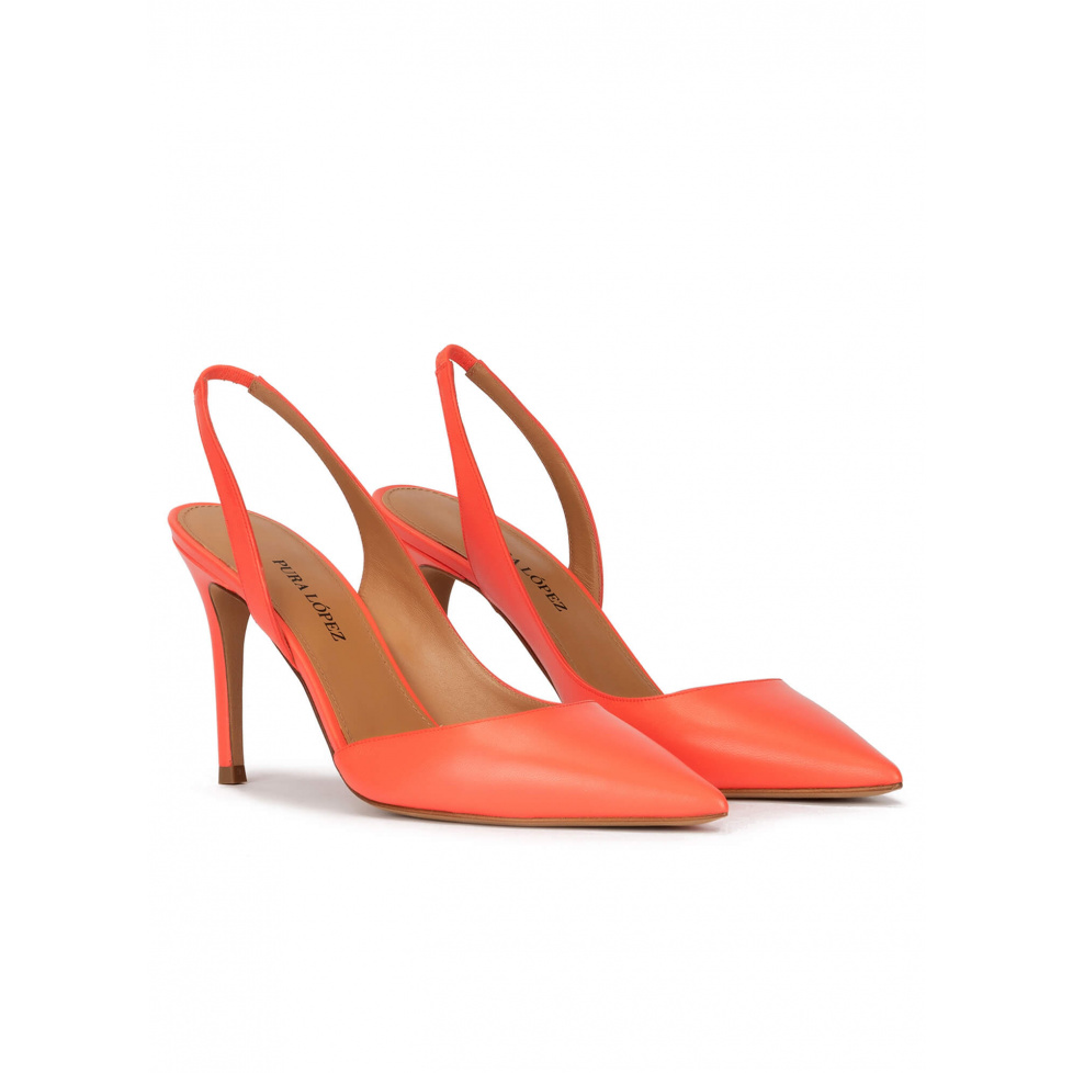 Slingback high heel point-toe pumps in coral leather