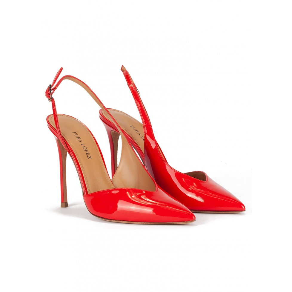 Red patent leather asymmetric heeled slingback pumps